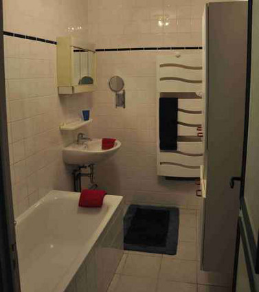 Bathroom with a bath and a shower.