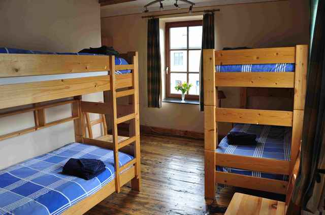 The room with two bunks. Four young  people can stay in those four beds. Sink in the room.