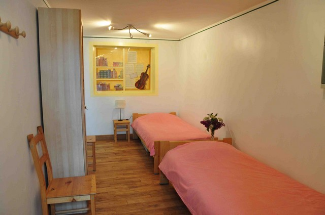 "Room with two single beds. This room communicates with the second bathroom and with the bedroom called  ""the patriarch""."