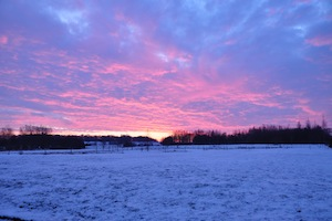 A beautiful sunset over snowy Loyers campaigns.