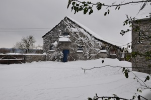 The farmyard under a thick blanket of snow.